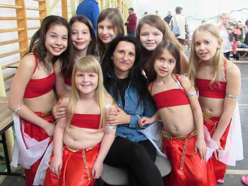 Real Pearl belly dance group with their instructor