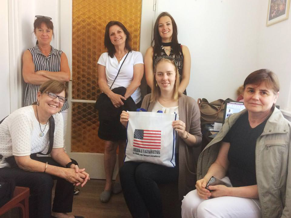 Fulbright scholarship grantees and a U.S. Embassy member visiting Real Pearl HQ